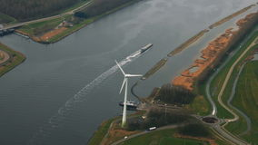 Netherlands aerial panoram view on river ship ferry wind turbine power plant ecology stock video