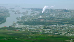 Netherlands aerial view on polder ship safety sea dam industrial plant smoke stock footage