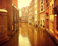 Netherlands. Amsterdam. Ancient picturesque canal in the background ancient architecture at sunset Stock Images