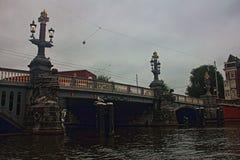 Netherlands. Amsterdam bridge. Evening. Bad weather. Netherlands. Bridge over the Amstel river. Riverside view stock image