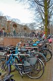 Amsterdam is a city of bicycles. View of the canal and old tower Stock Image