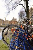 Amsterdam is a city of bicycles. View of the canal and old tower Stock Photo