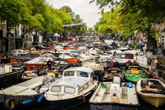 Amsterdam many boats floating in canal water Holland river stock image
