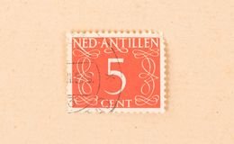 A stamp printed in The Netherlands Antilles shows it`s value, circa 1950. The Netherlands Antilles - Circa 1950: A stamp printed in The Netherlands Antilles stock photography