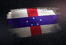 Netherlands Antilles Flag Made of Metallic Brush Paint on Grunge. Dark Wall stock photography