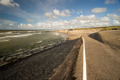 Netherlands beach. Lawn sky sea Royalty Free Stock Photo