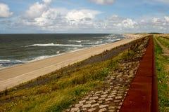Netherlands beach. Lawn sky sea clouds Stock Photos