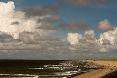 Netherlands beach. Lawn sky sea clouds Stock Image