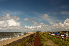 Netherlands beach. Lawn sky sea clouds Stock Photography