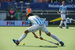 Netherlands beats Argentinia during the Hockey World Cup 2014. THE HAGUE, NETHERLANDS - JUNE 1: Argentinian player Rey is about tho play the ball during the stock photography