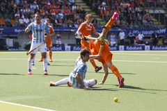 Netherlands beats Argentinia during the Hockey World Cup 2014. THE HAGUE, NETHERLANDS - JUNE 1: Dutch player de Wijn is tackeld by the Argentinian player Rossi royalty free stock images