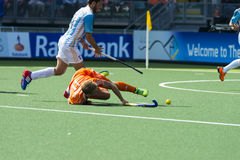Netherlands beats Argentinia during the Hockey World Cup 2014. THE HAGUE, NETHERLANDS - JUNE 1: Dutch player Hertzberger is laying on the ground. Brunet is stock photos