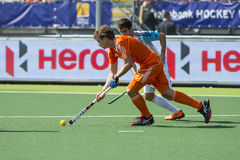 Netherlands beats Argentinia during the Hockey World Cup 2014. THE HAGUE, NETHERLANDS - JUNE 1: Dutch player Jonker is playinge the ball, Argentinian player Rey stock photo