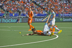 Netherlands beats Argentinia during the Hockey World Cup 2014. THE HAGUE, NETHERLANDS - JUNE 1: Dutch player Kemperman is tackeled by Argentinian player Gilardi stock image