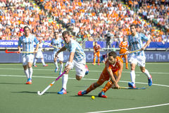 Netherlands beats Argentinia during the Hockey World Cup 2014. THE HAGUE, NETHERLANDS - JUNE 1: Dutch player Verga is about to shoot the bal towards the goal stock photography