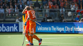 Netherlands beats Argentinia during the Hockey World Cup 2014. THE HAGUE, NETHERLANDS - JUNE 1: Dutch players van der Weerden and Kemperman celebrating a goal royalty free stock photos