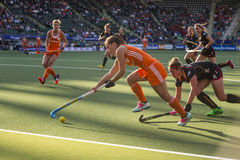 Netherlands beats Belgium during the Hockey World Cup 2014. THE HAGUE, NETHERLANDS - JUNE 2: Dutch Jonker is lifting her stick to control the ball, Belgium stock photography
