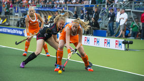 Netherlands beats Belgium during the Hockey World Cup 2014. THE HAGUE, NETHERLANDS - JUNE 2: Dutch Maasakker is is playing the ball when Belgium player Boon is stock photos