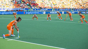 Netherlands beats Belgium during the Hockey World Cup 2014. THE HAGUE, NETHERLANDS - JUNE 2: Dutch van As is tanking a corner during the match The Netherlands royalty free stock images