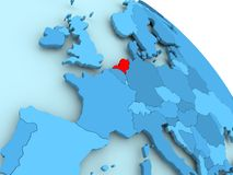 Netherlands on blue globe. Netherlands highlighted on blue 3D model of political globe. 3D illustration Royalty Free Stock Images