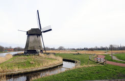 Netherlands Canal with Typical Windmill Royalty Free Stock Photos