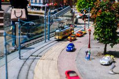 Netherlands. Den Haag. Miniature park Madurodam.July 2016. Old tram in the street. Mini human figures, cars, buildings, trains. stock image