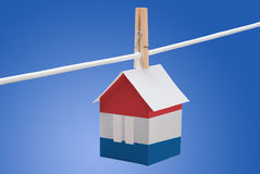 Netherlands, dutch flag on paper house. Concept - Netherlands, dutch flag painted on a paper house hanging on a rope Royalty Free Stock Images