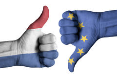 Netherlands and Europe flag on human male thumb up and down hand. Netherlands  and Europe flag on human male thumb up and down hands Stock Images