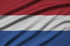 Netherlands flag is depicted on a sports cloth fabric with many folds. Sport team banner. Netherlands flag is depicted on a sports cloth fabric with many folds stock photos
