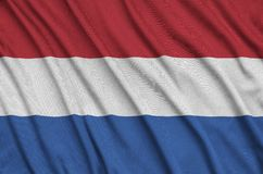 Netherlands flag is depicted on a sports cloth fabric with many folds. Sport team banner. Netherlands flag is depicted on a sports cloth fabric with many folds vector illustration