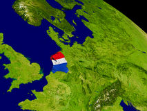 Netherlands with flag on Earth Royalty Free Stock Photos