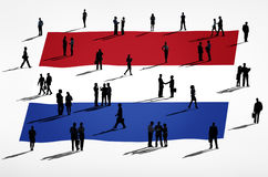 Netherlands flag and a group of business people Stock Photos