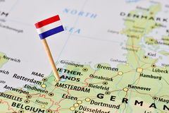 Netherlands flag on map. Netherlands paper flag pin on a map (series image Stock Photos
