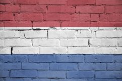 Netherlands flag is painted onto an old brick wall royalty free stock image