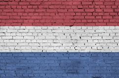 Netherlands flag is painted onto an old brick wall royalty free illustration