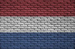 Netherlands flag is painted onto an old brick wall stock illustration