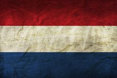 Netherlands Flag on Paper. Flag on an old Paper Texture Stock Photo