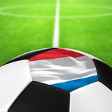 Netherlands Flag Pattern of a soccer ball in green grass Royalty Free Stock Photography