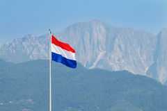 Netherlands flag waves in the wind in Forte dei Marmi Stock Image