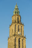 The Netherlands - Groningen. Detail of the famous Martinitower in the centre of Groningen against a clear blue sky Royalty Free Stock Photo