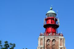 Former church-tower is now functioning as lighthouse. Netherlands,Holland,Dutch,Zeeland,Westkapelle,july 2017:Former church-tower is now functioning as royalty free stock photos