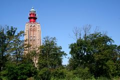 Former church-tower is now functioning as lighthouse. Netherlands,Holland,Dutch,Zeeland,Westkapelle,july 2017:Former church-tower is now functioning as royalty free stock image