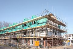 Unfinished houses with scaffold boards at an construction site in Leidschendam, royalty free stock photos