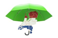 Netherlands map under umbrella. Security and protect or insuranc Stock Photos