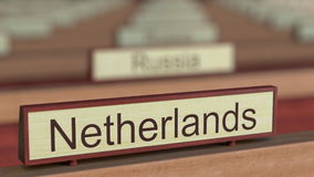 Netherlands name sign among different countries plaques at international organization. 3D rendering Stock Photo