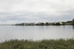 Holyday resort in Den Oever. Netherlands, North-Holland, Den oever, july 2018: Holyday resort in Den Oever seen in a distance over water stock photo