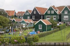 Children play freely in spite of the mass tourism. Netherlands,North Holland,Marken, june2016: Children play freely in spite of the mass tourism royalty free stock photography
