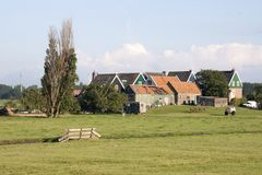 Residential area, on elevated ground, Yard called. Netherlands,North Holland,Marken, june2016: Residential area, on elevated ground, Yard called Stock Photography