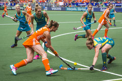 Netherlands on the offense. THE HAGUE, NETHERLANDS - JUNE 14: Lidewij Welten tries to rush through the Australian Defence into the cirlcle during the final match royalty free stock image