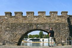 Ancient water gate at the river Meuse in Maastricht. The Netherlands, Province Limburg, City Maastricht: The water gate is a water gate, city gate, in the Wyck Royalty Free Stock Photography